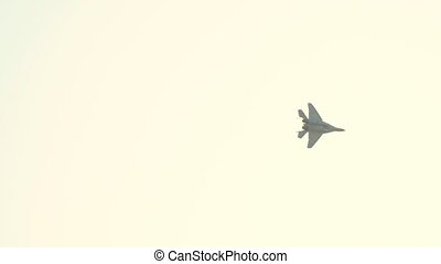 A reactive plane flying in the sky and performing a show - getting lost in the white bright sky