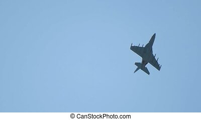 A reactive plane flying up in the blue clear sky