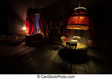 A realistic dollhouse living room with furniture and window at night. Artwork table decoration with handmade realistic dollhouse.