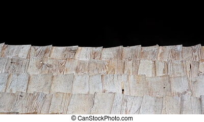 A really close footage of the close-up view of the old cabin cedar wooden shingle shake roof