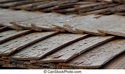 A really close footage of the Up-close view of the cabin wooden cedar shingle shake roof