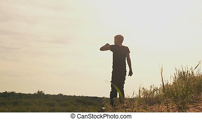 a rear view of a boy raises his hand up slow motion video -...