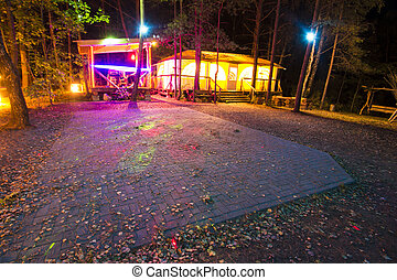 a recreation place in forest at night