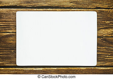 A rectangle empty white plate on the rustic wooden floor.