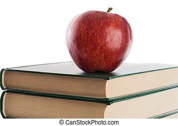 A red apple on top of books