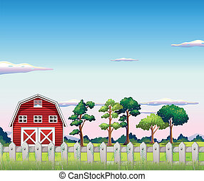 A red barnhouse inside the fence