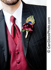boutonniere - a red boutonniere corsage with a peacock ...