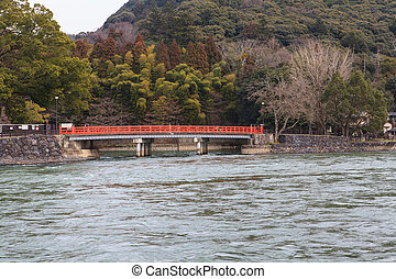 A red bridge over water
