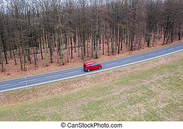 a red car on a street from above