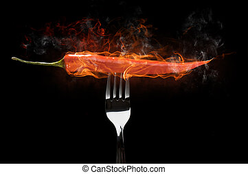 chili pepper - a red chili pepper on the fork