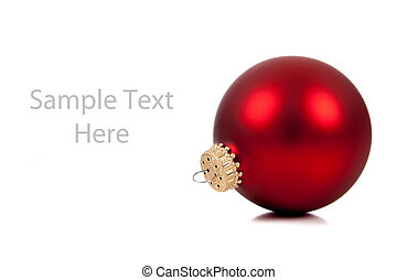 A red Christmas ornament/bauble on white with copy space