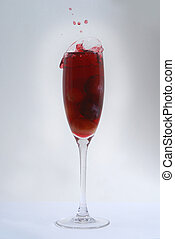 A red cocktail in a glass