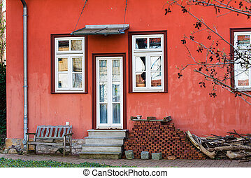 Red country house in Erfurt with white door on the terrace