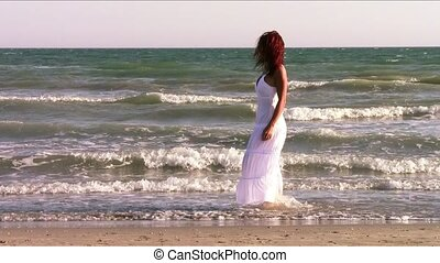 a red-haired woman at the seaside
