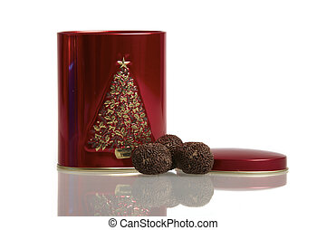 A red metal box with three rum balls on white background