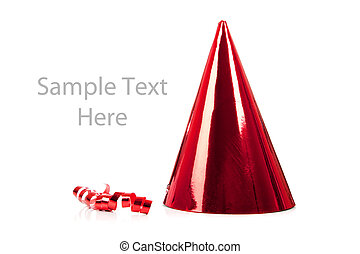A red party hat and streamer on white
