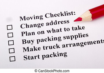 Moving Checklist - A red pencil laying on a Moving Checklist...