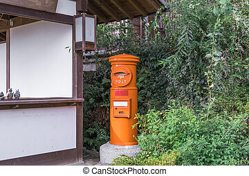 A red post box in the old town or old buildings of Magome of Nagano Prefecture, JAPAN.