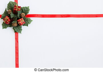 red ribbon with christmas decoration on a white background