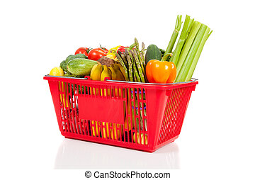 A red shopping  basket with vegetables
