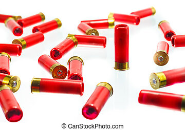 A red shotgun shell bullet on a white background.