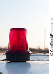 A red siren on a top of a car