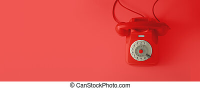A red vintage dial telephone.
