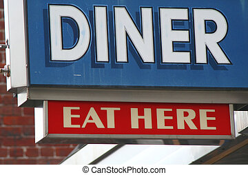 A Red, White, and Blue Diner Sign is Displayed.