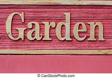 Red wooded garden sign