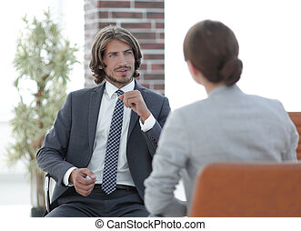A relaxed conversation of a man and a woman in the office -...