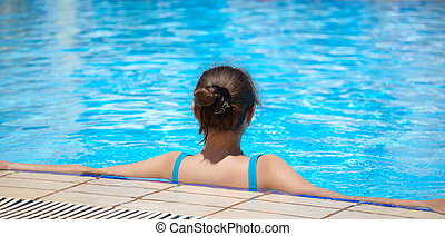 woman is in the swimming pool