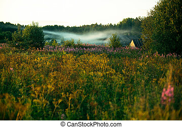 A remote Russian village early in the morning at dawn.