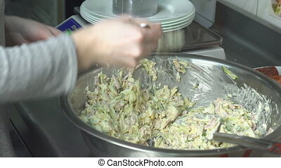 A restaurant chef decontaminates a salad in portions and...
