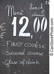 A restaurant menu that indicates lunch at a fixed price of twelve euro