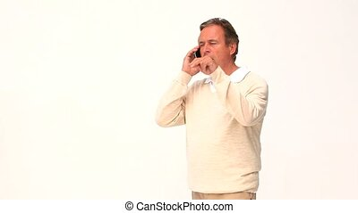 A retired man getting nervous on the phone