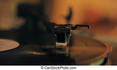 Record player turntable 4k stock footage. A record player turntable with it's stylus running along a vinyl record, dropping stylus needle on vinyl record playing