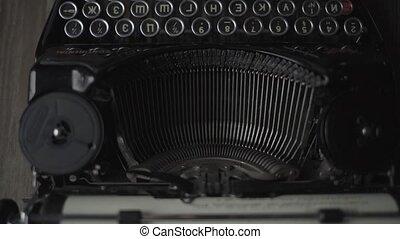a retro typewriter in work closeup