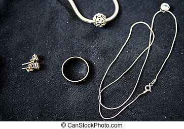 ring and bracelet and earrings and chain with pendant