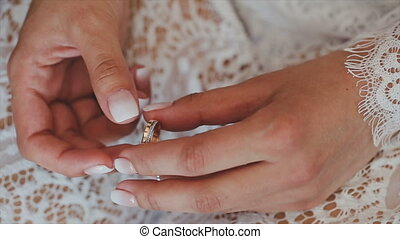 A ring in the hand of a girl who looks at him