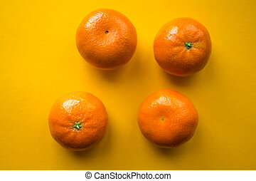ripe mandarins on a orange bacground