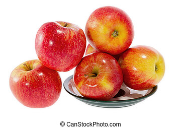 ripe red apples on a plate