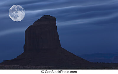 Risng moon over Monument Valley
