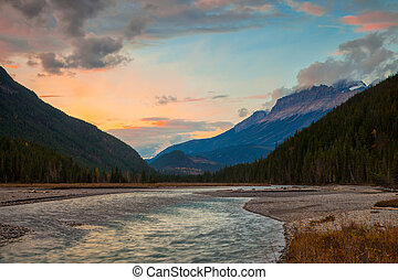 A river in the mountains at sunset