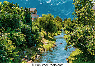 The Oberaukanal flowing through the outskirts of Vaduz, Liechtenstein