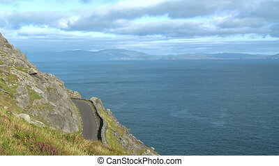 A road by a cliff overlooking the sea - Wide shot from a...