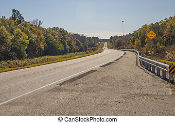 A road in the country with Fall colors and blue skies  colorful