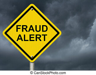 A road warning sign against a stormy sky with words Fraud Alert, Warning of Fraud