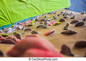 A rock climbing wall for background. view from above