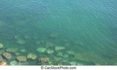 A Rocks At Green Ocean Coast