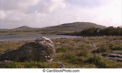 A rocky terrain in Ireland - A steady wide shot of a rocky...